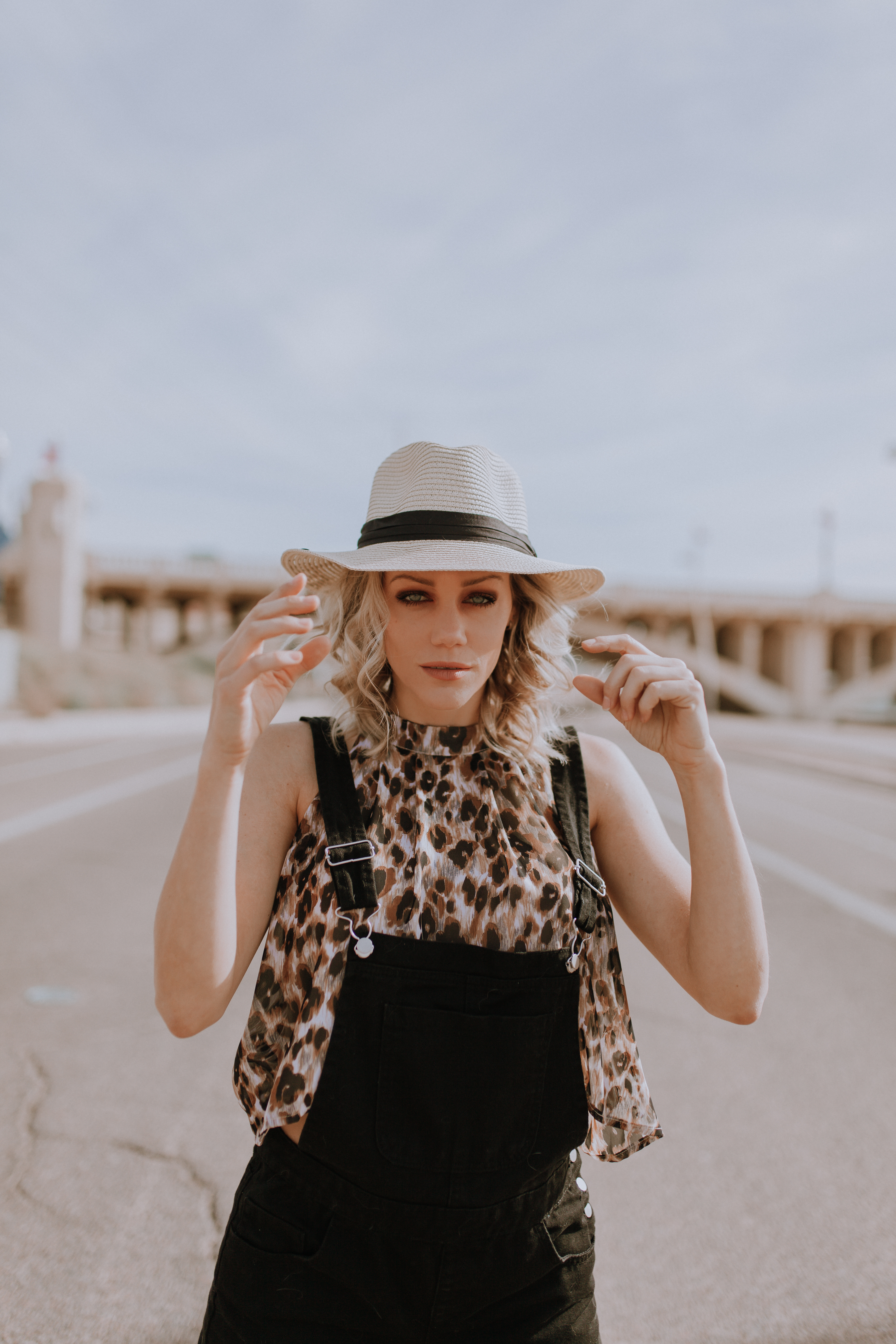 black overall outfit with leopard shirt